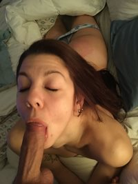 A dirty girl loves getting her ass spanked while she has a mouth full..