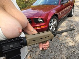 Happy Hump Day.Tits, Cars and Guns, doesn't get any more American. An oldie...