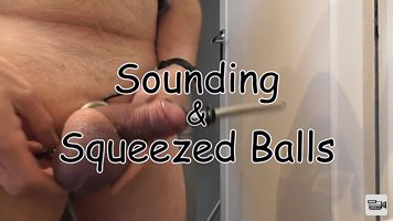 Sounding & Squeezed Balls Squeezing my testicles - while my cock & balls ar...